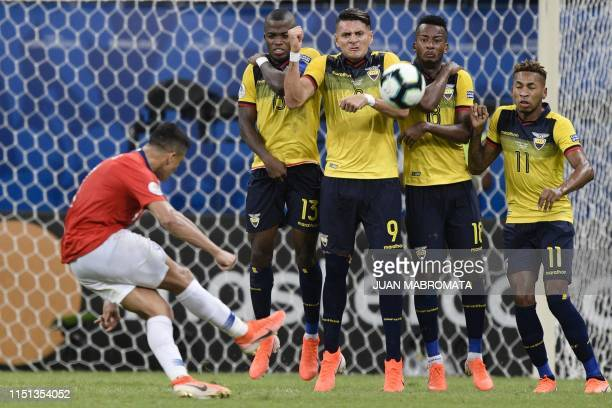 Chile's Alexis Sanchez takes a free-kick against Ecuador during their Copa America football tournament group match at the Fonte Nova Arena in...