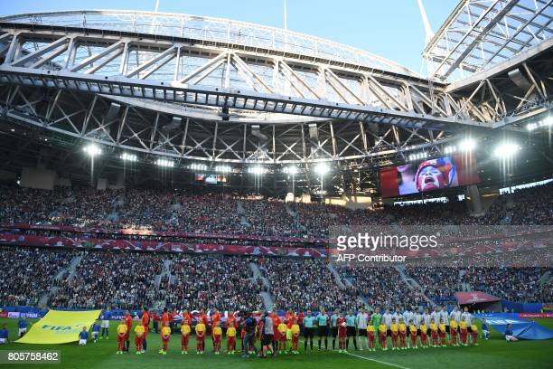 Chile's and Germany's players listen to the national anthems ahead of the 2017 Confederations Cup final football match between Chile and Germany at...