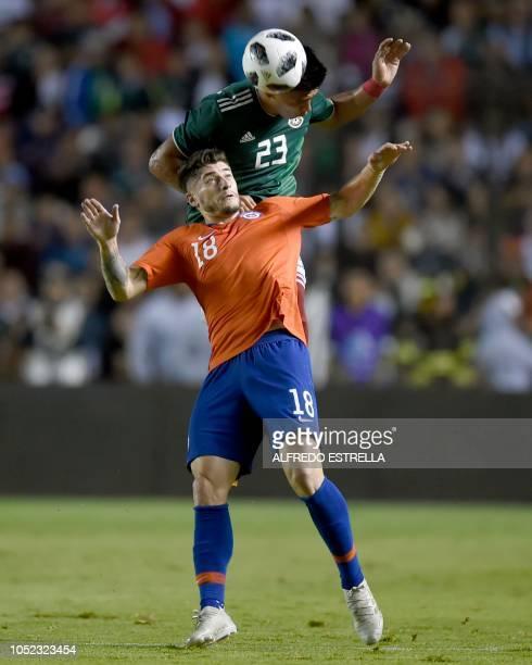 Chile's Angel Sagal vies for the ball with Mexico's Jesus Gallardo during their friendly football match at the La Corregidora stadium in Queretaro...