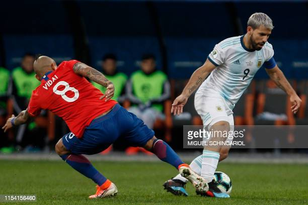 Chile's Arturo Vidal and Argentina's Sergio Aguero vie for the ball during their Copa America football tournament thirdplace match at the Corinthians...