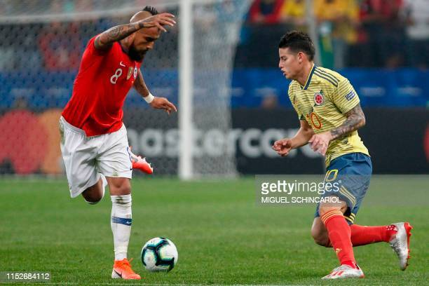 Chile's Arturo Vidal and Colombia's James Rodriguez vie for the ball during their Copa America football tournament quarterfinal match at the...