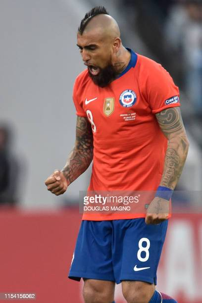 Chile's Arturo Vidal celebrates after scoring a penalty against Argentina during their Copa America football tournament third-place match at the...