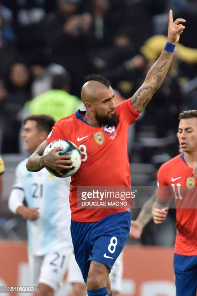 Chile's Arturo Vidal celebrates after scoring a penalty against Argentina during their Copa America football tournament thirdplace match at the...