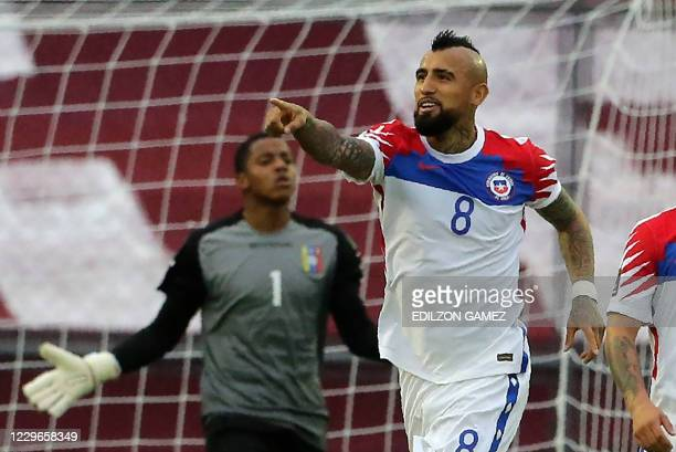 Chile's Arturo Vidal celebrates after scoring against Venezuela during their closed-door 2022 FIFA World Cup South American qualifier football match...
