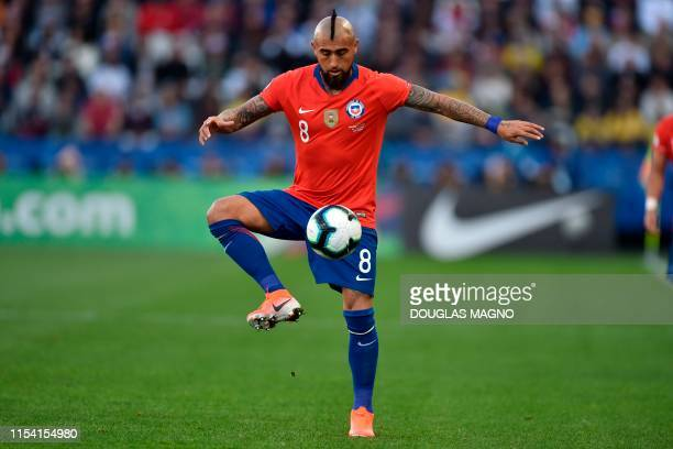 Chile's Arturo Vidal controls the ball during the Copa America football tournament thirdplace match against Argentina at the Corinthians Arena in Sao...