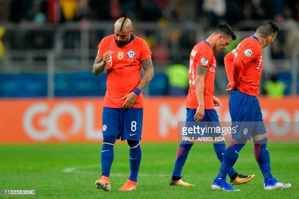 Chile's Arturo Vidal Gary Medel and Charles Aranguiz return to the field for the second half of their Copa America football tournament semifinal...