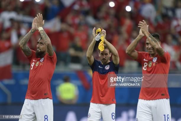 Chile's Arturo Vidal Jose Pedro Fuenzalida and Gonzalo Jara acknowledge the crowd after defeating Ecuador 21 in a Copa America football tournament...