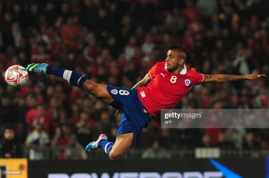 Chile's Arturo Vidal kicks the ball during their FIFA World Cup Brazil 2014 South American qualifier football match against Bolivia at the Nacional stadium in Santiago, Chile,on June 11, 2013.