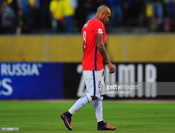 Chile's Arturo Vidal leaves the field in dejection after the Russia 2018 World Cup football qualifier match against Ecuador in Quito on October 6...