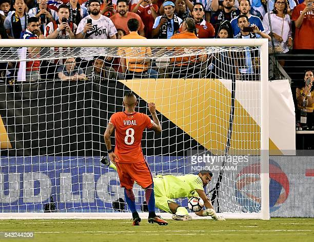 Chile's Arturo Vidal reacts after Argentina's goalkeeper Sergio Romero stopped his shot during the penalty shootout of the Copa America Centenario...