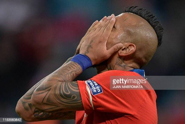 Chile's Arturo Vidal reacts during the Copa America football tournament semifinal match against Peru at the Gremio Arena in Porto Alegre Brazil on...