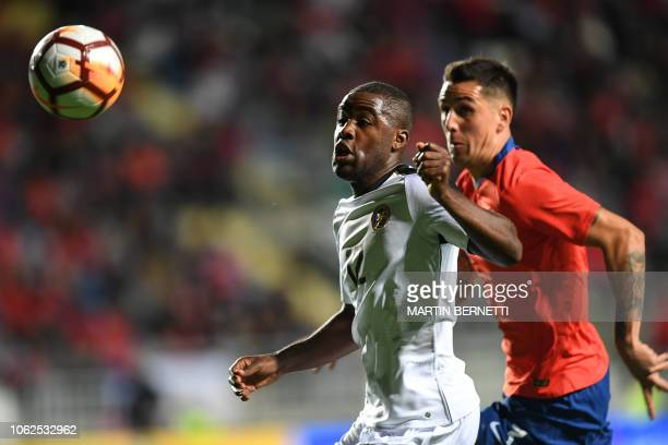 Chile's Benjamin Kuscevic vies for the ball with Costa Rica's player Joel Campbell during a friendly football match at El Teniente stadium in...