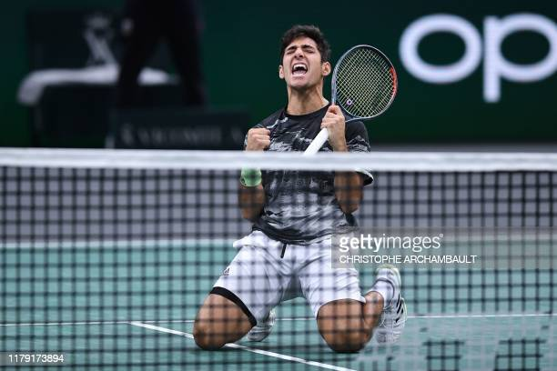 Chile's Christian Garin celebrates after winning against France's Jeremy Chardy during their men's singles tennis match on day four of the ATP World...