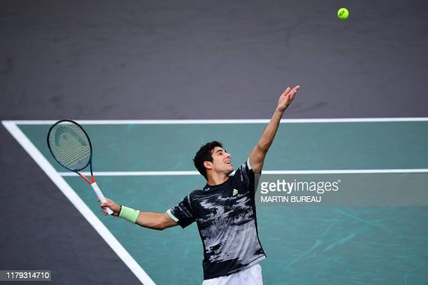 Chile's Christian Garin eyes the ball as he serves the ball to Bulgaria's Grigor Dimitrov during their men's singles quarterfinal tennis match at the...