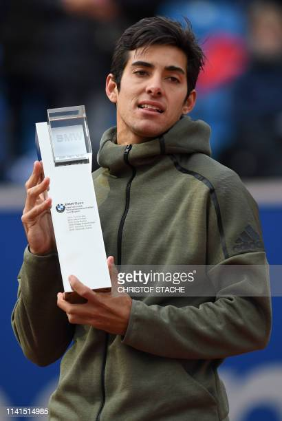 Chile's Christian Garin poses with the trophy after winning the final match against Italy's Matteo Berrettini at the ATP tennis BMW Open in Munich...