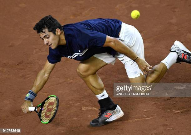 TOPSHOT Chile's Christian Garin returns the ball to Argentina's Diego Schwartzman during their Davis Cup Americas Zone Group I second round match at...