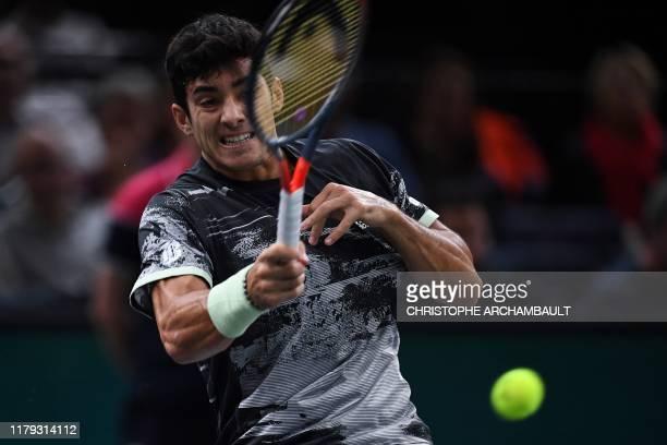 Chile's Christian Garin returns the ball to Bulgaria's Grigor Dimitrov during their men's singles quarterfinal tennis match at the ATP World Tour...