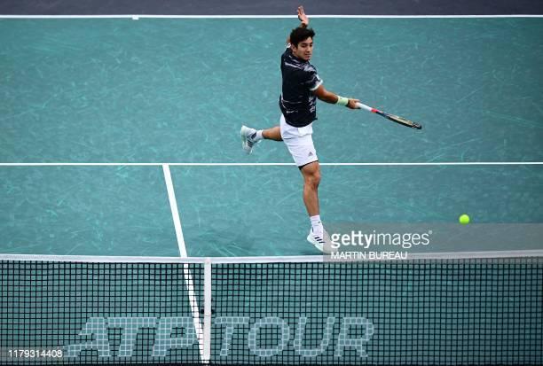 TOPSHOT Chile's Christian Garin returns the ball to Bulgaria's Grigor Dimitrov during their men's singles quarterfinal tennis match at the ATP World...