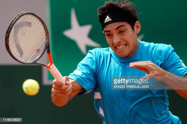 Chile's Christian Garin returns the ball to Reilly Opelka of the US during their men's singles first round match on day two of The Roland Garros 2019...