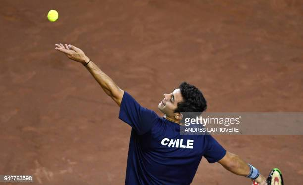 Chile's Christian Garin serves to Argentina's Diego Schwartzman during their Davis Cup Americas Zone Group I second round match at the Aldo Cantoni...