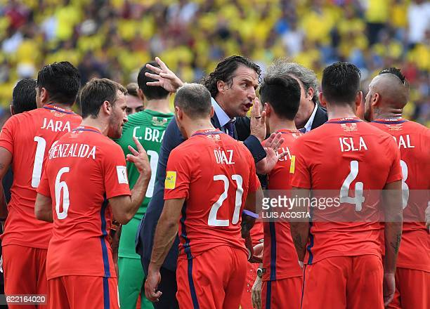 TOPSHOT Chile's coach Juan Antonio Pizzi talks to the players during the 2018 FIFA World Cup qualifier football match against Colombia in...