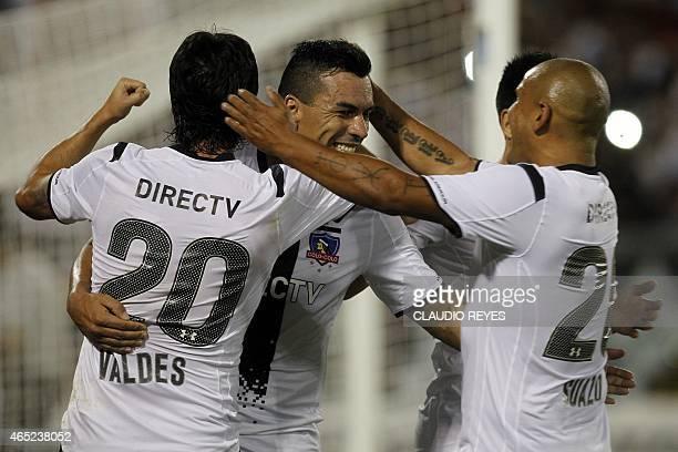 Chile's Colo Colo footballer Esteban Paredes celebrates with teammates after scoring against Mexico's Atlas during their Copa Libertadores football...