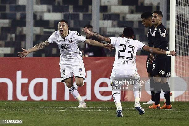 Chile's ColoColo Carlos Carmona celebrates after scoring against Brazil's Corinthians during their Copa Libertadores football match at the Monumental...