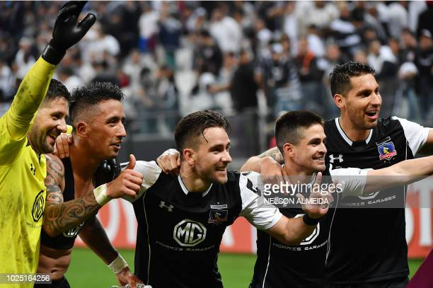 Chile's ColoColo players celebrate after their team defeated Brazil's Corinthians in their 2018 Copa Libertadores football match at Arena Corinthians...