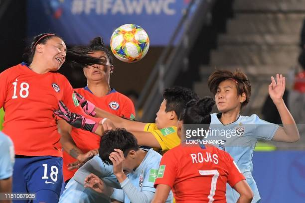 Chile's defender Camila Saez vies with Thailand's goalkeeper Waraporn Boonsing during the France 2019 Women's World Cup Group F football match...