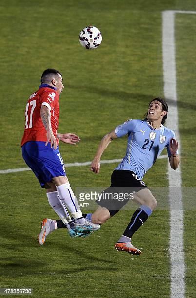 Chile's defender Gary Medel and Uruguay's forward Edinson Cavani vie for the ball during their 2015 Copa America football championship quarterfinal...