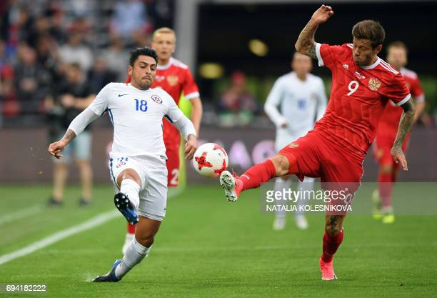 Chile's defender Gonzalo Jara and Russia's forward Fedor Smolov vie for the ball during a friendly football match between Russia and Chile at the...