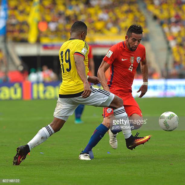 Chile's defender Mauricio Isla and Colombia's defender Farid Diaz vie for the ball during their 2018 FIFA World Cup qualifiers football match in...