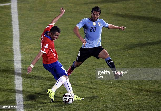 Chile's defender Mauricio Isla shoots to score against Uruguay during their 2015 Copa America football championship quarterfinal match in Santiago on...