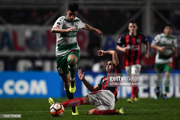 Chile's Deportes Temuco forward Lucas Campana vies for the ball with Argentina's San Lorenzo defender Gabriel Hernan Rojas during their Copa...