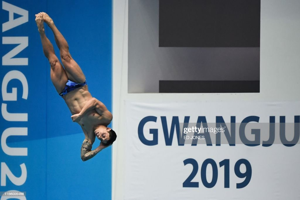 Chile's Diego Carquin competes in the men's 3m springboard