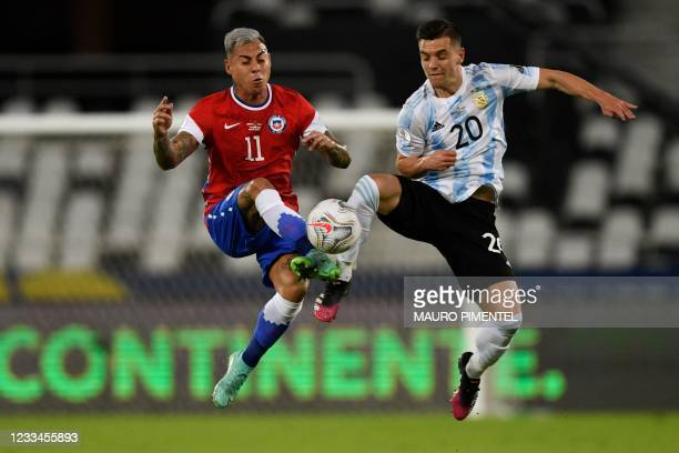 Chile's Eduardo Vargas and Argentina's Giovani Lo Celso vie for the ball during their Conmebol Copa America 2021 football tournament group phase...