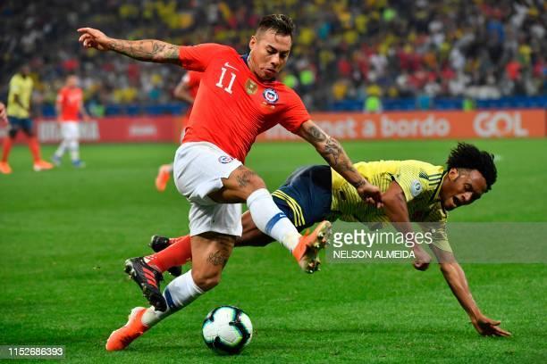 TOPSHOT Chile's Eduardo Vargas and Colombia's Juan Guillermo Cuadrado vie for the ball during their Copa America football tournament quarterfinal...