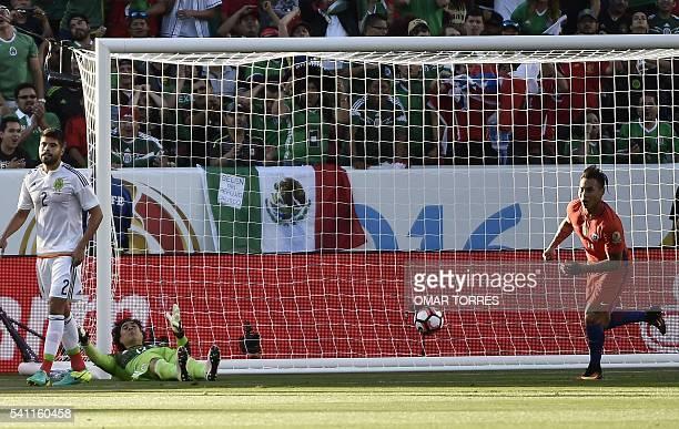 Chile's Eduardo Vargas celebrates as Mexico's goalkeeper Guillermo Ochoa fails to stop a ball kicked by Edson Puch during the Copa America Centenario...