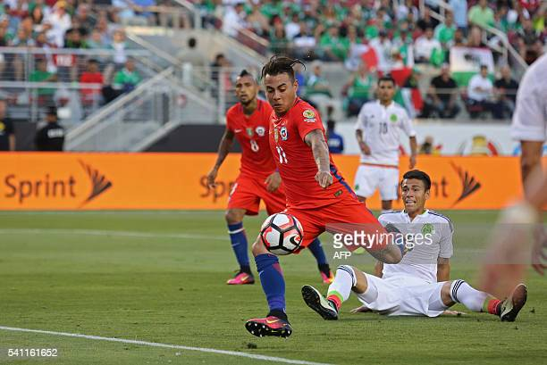 Chile's Eduardo Vargas shoots to score against Mexico during the Copa America Centenario quarterfinal football match in Santa Clara California United...
