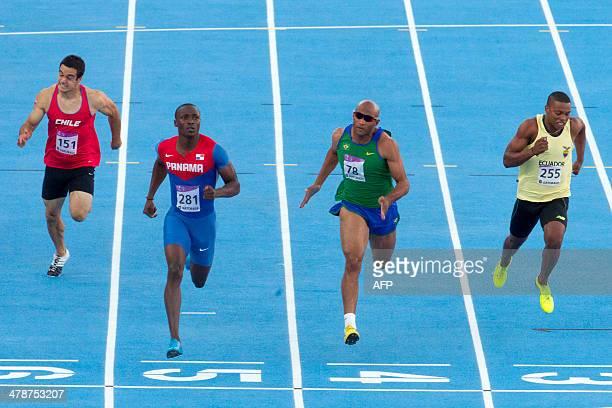 Chile's Enrique Polanco Panama's Alonso Edward Brazil's Jefferon Liberato and Ecuador's Alex Quinonez compete in the men's 100M final during the X...