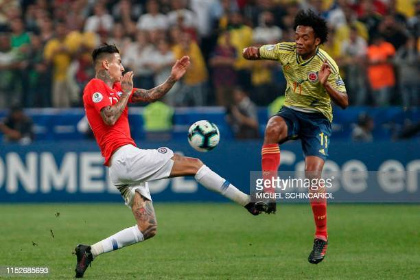 Chile's Erick Pulgar and Colombia's Juan Guillermo Cuadrado vie for the ball during their Copa America football tournament quarter-final match at the...