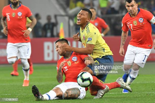 Chile's Erick Pulgar and Colombia's Roger Martinez during their Copa America football tournament quarterfinal match at the Corinthians Arena in Sao...