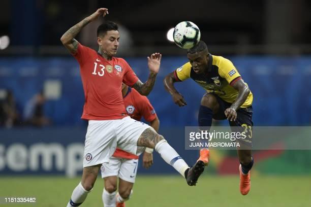 Chile's Erick Pulgar and Ecuador's Jhegson Sebastian Mendez vie for the ball during their Copa America football tournament group match at the Fonte...
