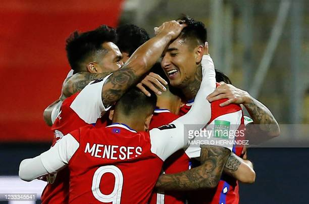 Chile's Erick Pulgar celebrates with teammates after scoring against Bolivia during their South American qualification football match for the FIFA...