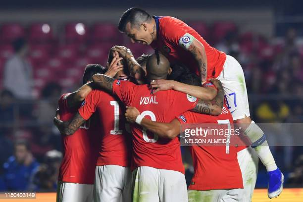 Chile's Erick Pulgar celebrates with teammates after scoring during a Copa America football tournament Group C match between Chile and Japan at the...