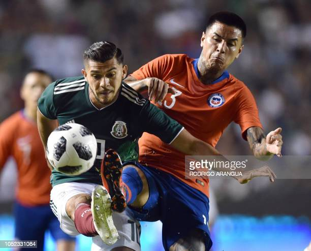 Chile's Erick Pulgar vieS for the ball with Henry Martin of Mexico during the friendly football match between Mexico and Chile at the La Corregidora...