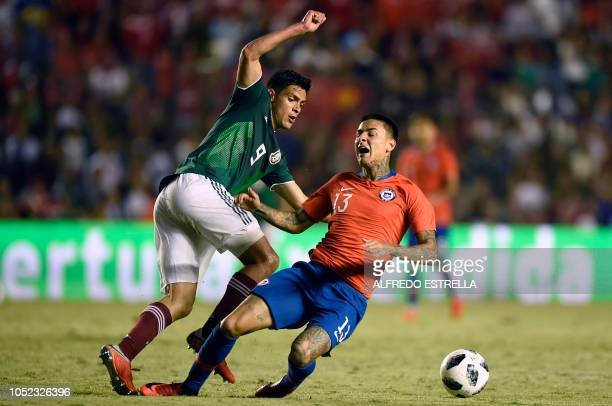 Chile's Erick Pulgar vies for the ball with Mexico's Raul Jimenez during the friendly football match between Mexico and Chile at the La Corregidora...