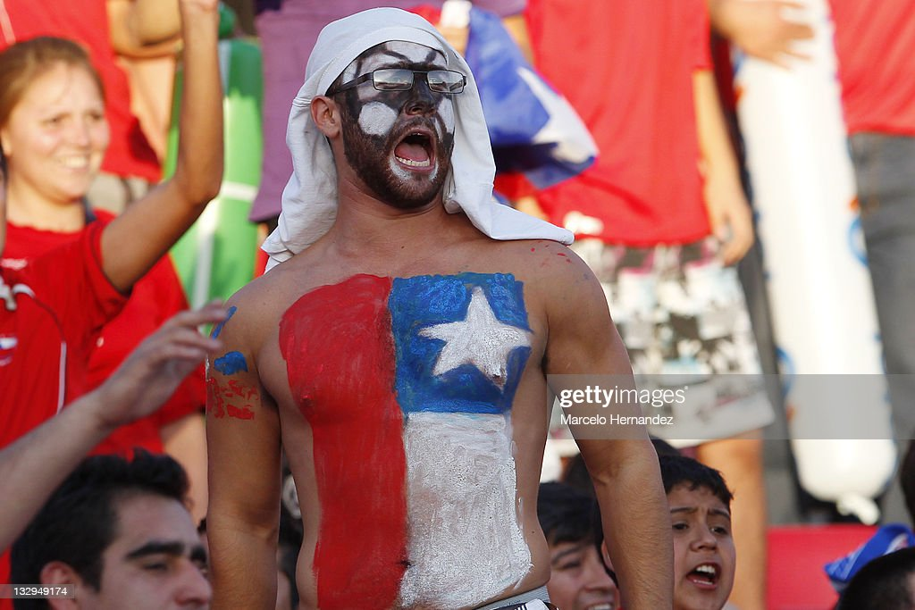 Chile's fans cheer to their team during the match between Chile and Paraguay as part of the South American Qualifiers for Brazil 2014 FIFA World Cup on November 15, 2011 in Santiago, Chile.