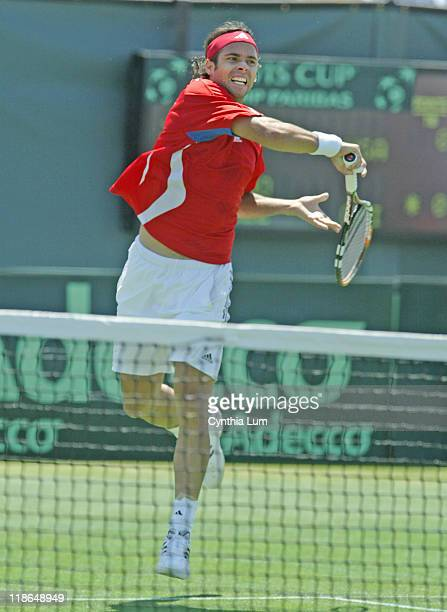 Chile's Fernando Gonzalez hits a return to the USA's James Blake during the Davis Cup match between the two countries at Mission Hills Country Club,...