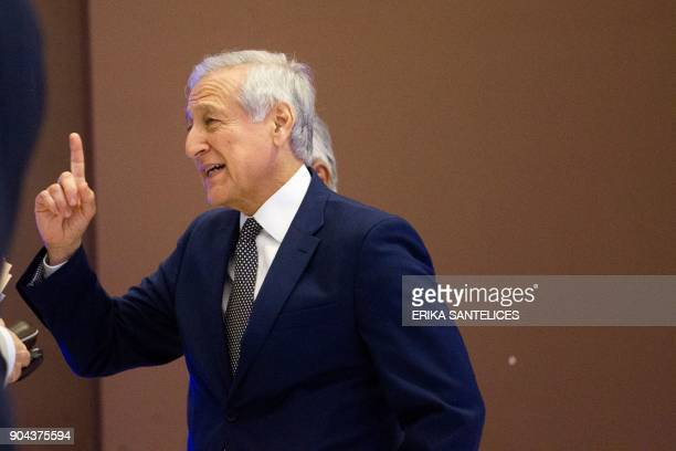 Chile's Foreign Minister Heraldo Munoz gestures before press a conference after the meeting between Venezuelan government representatives and members...